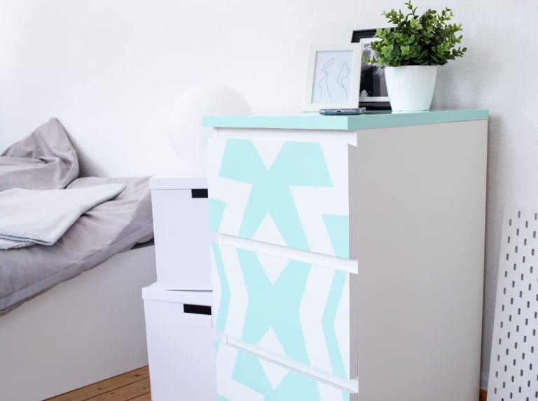 Nightstand featuring the new DIY upcycling look with paint adhesive foil in Mint and geometric patterns in White.