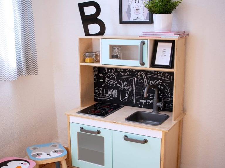 Wooden play kitchen for kids with rear wall in blackboard film and new doors designed with adhesive foil