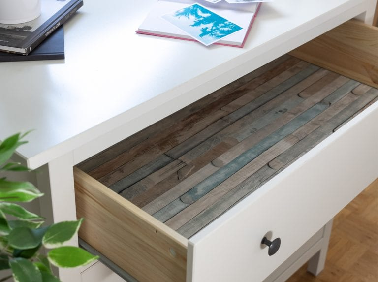 View into drawer whose bottom is covered with d-c-fix© adhesive foil Rio Ocean in the look of colourful beach wood.