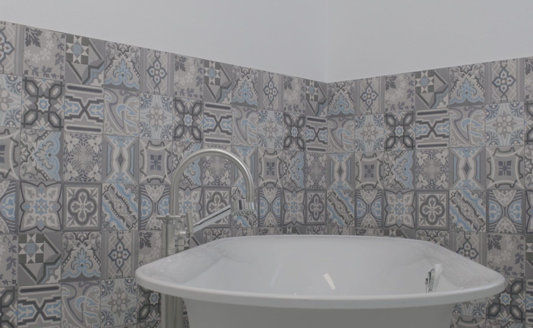 Get that newly tiled look in the bathroom with d-c-wall® Simenta ceramics wallpaper.