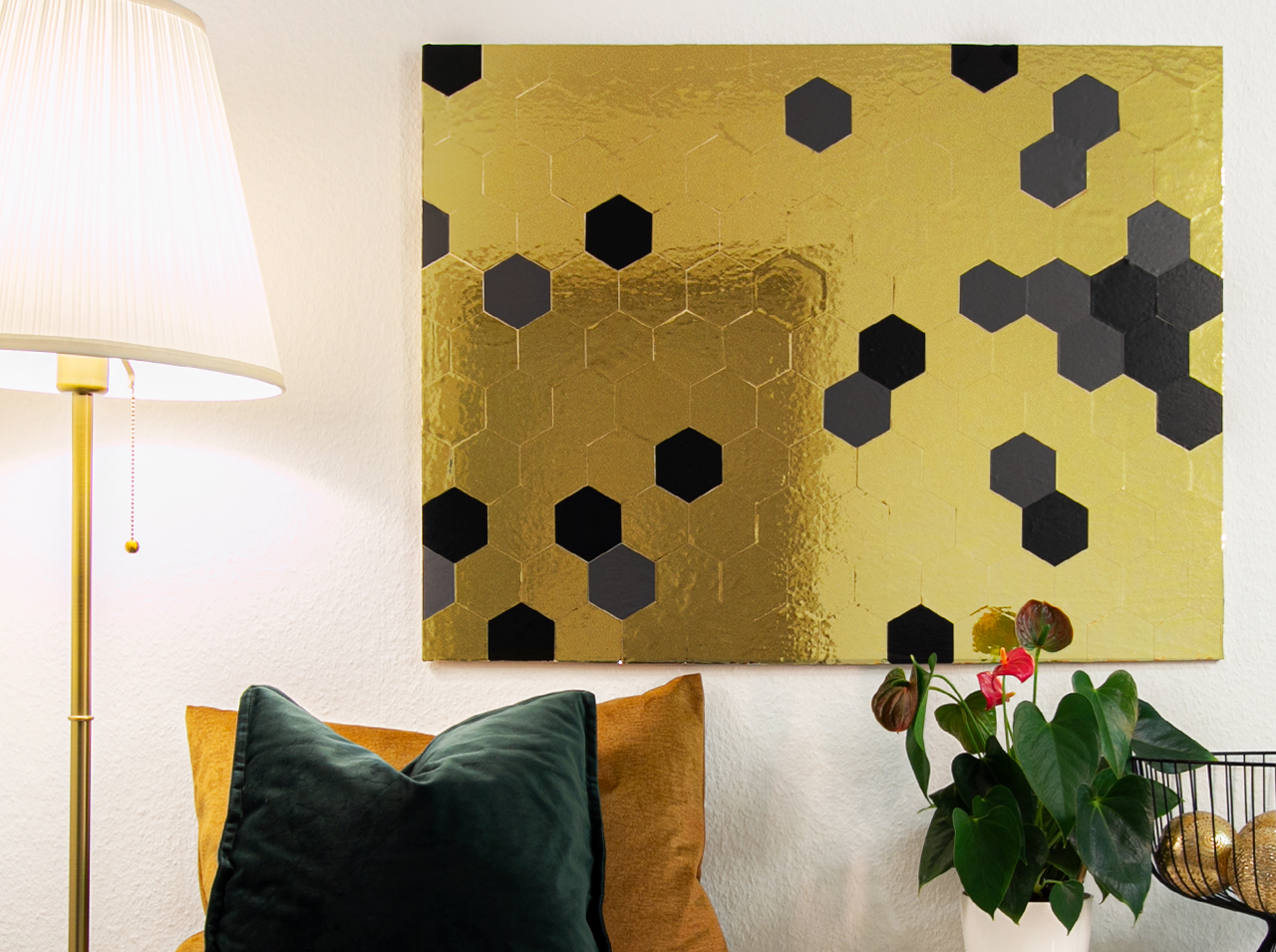 DIY geometric wall design of honeycomb shaped wooden panels made of d-c-fix® film in gold, anthracite and black.
