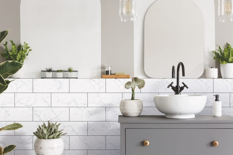 New tile look in the bathroom with d-c-fix® ceramics wall covering simply applied yourself.