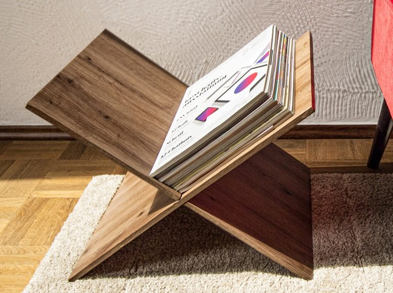 DIY magazine rack made of two wooden boards covered in d-c-fix® Artisan Oak adhesive foil and slotted together.